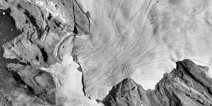 Gieseke Glacier in Northwest Greenland. Aerial image showing the Gieseke glacier in 1985. Information about the extent of the ice during the Little Ice Age is used to calculate the mass loss of the Greenland Ice Sheet during the twentieth century. Credit: Anders Anker Bjørk, Natural History Museum of Denmark